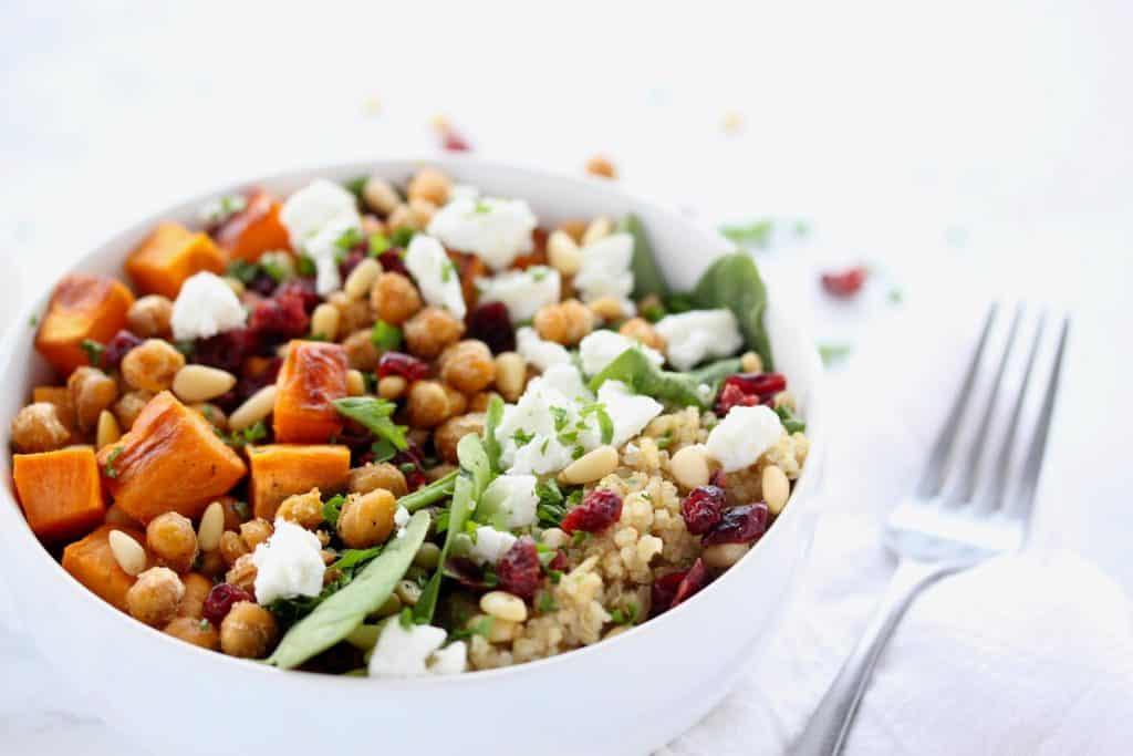Sweet potato and quinoa salad in white bowl.