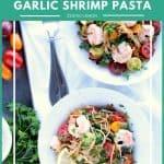Two white bowls of shrimp pasta on white napkin.